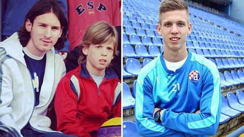 Danil Olmo ngày còn là cậu nhóc ở lò La Masia chụp ảnh cùng Messi