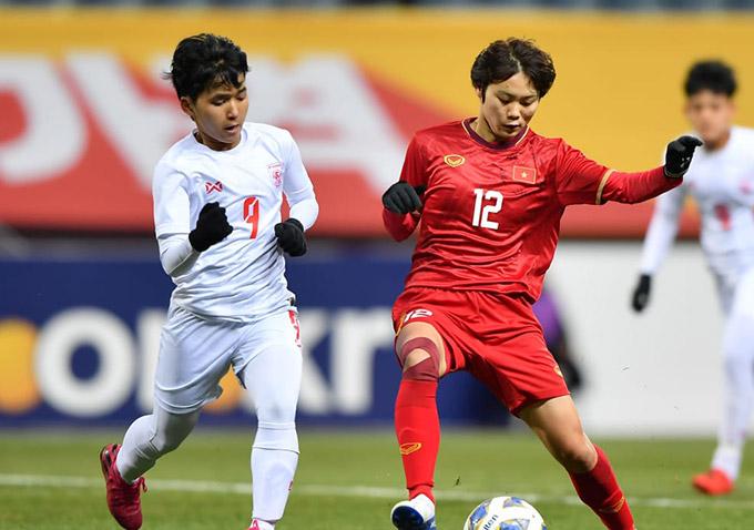ĐT nữ Việt Nam gặp nhiều khó khăn trong hiệp 1 - Ảnh: AFC