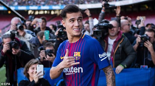 Coutinho đã cười rất tươi khi được đến Camp Nou