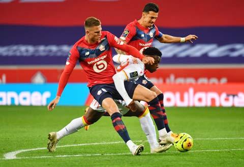 Cặp trung vệ Botman (trái) và Fonte của Lille đã hóa giải vô số ngôi sao tấn công tại Ligue 1 mùa này