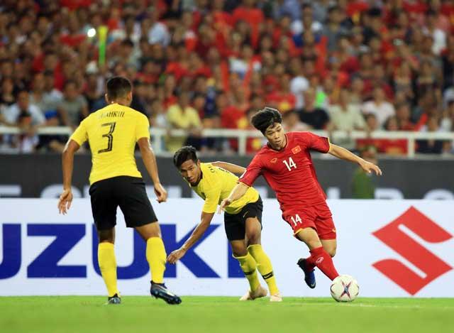 Công Phượng (phải) rất có duyên ghi bàn  vào lưới Malaysia - Ảnh: MINH TUẤN