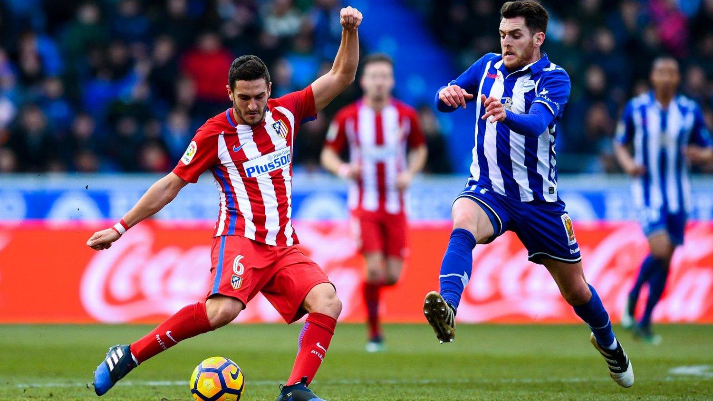 Espanyol (áo sọc xanh trắng) chỉ mới trở lại La Liga mùa này và vẫn chưa có chiến thắng nào