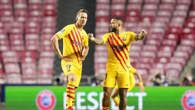 De Jong (trái) có những pha bỏ lỡ rất vô duyên trong trận thua thảm bại trước Benfica